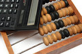 Old wooden abacus and electronic calculator Stock Photography
