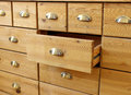 Old wooden antique chest of drawers with metal handles Royalty Free Stock Photo