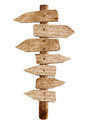 Old wooden arrow road sign isolated