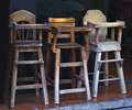 Old wooden baby highchairs in the restaurant Royalty Free Stock Photo