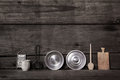 Old wooden background with miniatures of kitchen utensils like p pots spoon wood can and others in vintage style Stock Photos