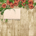 Old wooden background with paper roses and a place for text vintage photo Stock Photos
