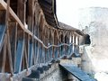 Old wooden balcony on the wall of the fortress big thick logs Stock Image