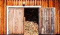 Old wooden barn with firewood Royalty Free Stock Photo