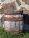 Old wooden barre barrel on stone wall in sunshine Royalty Free Stock Photography