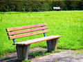 Old wooden bench at a meadow Stock Photos