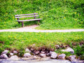 Old wooden bench at a meadow Stock Images