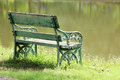 Old wooden bench near the lake Stock Photography