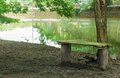Old wooden bench in park empty near the lake the Royalty Free Stock Image