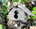 Old wooden birdhouse in garden Royalty Free Stock Photo