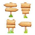 Old wooden blank cartoon sign boards in green grass isolated