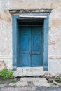 Old wooden blue door in the wall of old building. Royalty Free Stock Photo