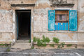 Old wooden blue door and window in the wall of old building. Royalty Free Stock Photo
