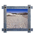 Old wooden blue frame against a white background with view of Llandudno sea side Royalty Free Stock Photo