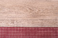 Old wooden board with checkered cloth as background Royalty Free Stock Photos