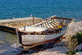 Old wooden boat broken by the sea Stock Photography