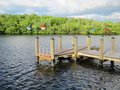 Old wooden boat dock by an inlet Stock Photos