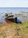 Old wooden boat on lake bank Royalty Free Stock Photo