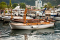 Old wooden boat used for touristic trips moored at sea harbor beautiful Stock Image