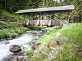 Old wooden bridge beautiful at a creek in austria Royalty Free Stock Photos