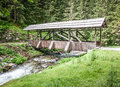 Old wooden bridge beautiful at a creek in austria Royalty Free Stock Image