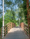 Old wooden bridge over the river with a handrail Royalty Free Stock Photo