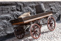 Old wooden cart on background of brick wall Royalty Free Stock Photo