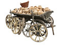 Old wooden cart full of clay pottery wheels and wicker basket i isolated over white background Stock Photos