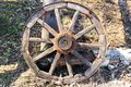 Old wooden cart wheel. The concept of outdated technologies, ecotourism Royalty Free Stock Photo