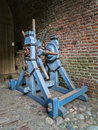 Old wooden castle winch wheel mechanism for opening gate Stock Images