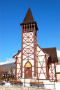 The old wooden Catholic church at ski resort Royalty Free Stock Photo