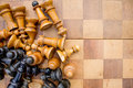 Old wooden chess pieces and board in a pile on a Stock Image