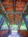 Old wooden covered bridge beautiful at a creek Royalty Free Stock Photography