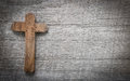 Old and wooden cross on a background with copy space for condolence text Royalty Free Stock Photos