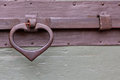 Old wooden door bolt handle gate iron lock and heart shaped Royalty Free Stock Photos