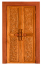 Old wooden door with carvings Royalty Free Stock Photography