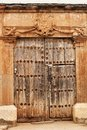 Old wooden door and coat of arms of the Holy Inquisition Royalty Free Stock Photo