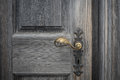 The old wooden door with doorhandle and keyhole Royalty Free Stock Photo