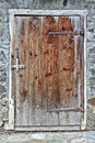 Old wooden door with grey field stone wall Royalty Free Stock Photo