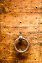 Old wooden door with knocker and nails Stock Image