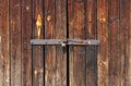 Old Wooden door locked with rusty padlock Royalty Free Stock Photo