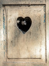 Old wooden door in meran tirol italy with a carved romantic heart Royalty Free Stock Photos
