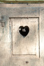 Old wooden door in meran tirol italy with a carved romantic he heart Royalty Free Stock Photography