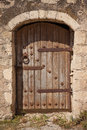 Old wooden door with metal decor in monastery toplou crete greece Royalty Free Stock Image