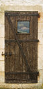 Old wooden door with metal hinges and lock Stock Photo