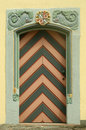 Old wooden door with ornament Stock Images