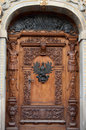 Old wooden door with ornaments Royalty Free Stock Photo