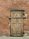 Old wooden door with padlock Stock Photo