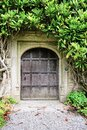 Old Wooden Door with Stone archway in English Manor House Royalty Free Stock Photo
