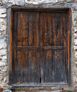 Old wooden door in a stone wall Stock Photography
